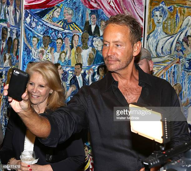 Fran Drescher's ex husband Peter Marc Jacobson with producer Daryl Roth attend the Fran Drescher Portrait unveiling at Sardi's on June 3 2014 in New...