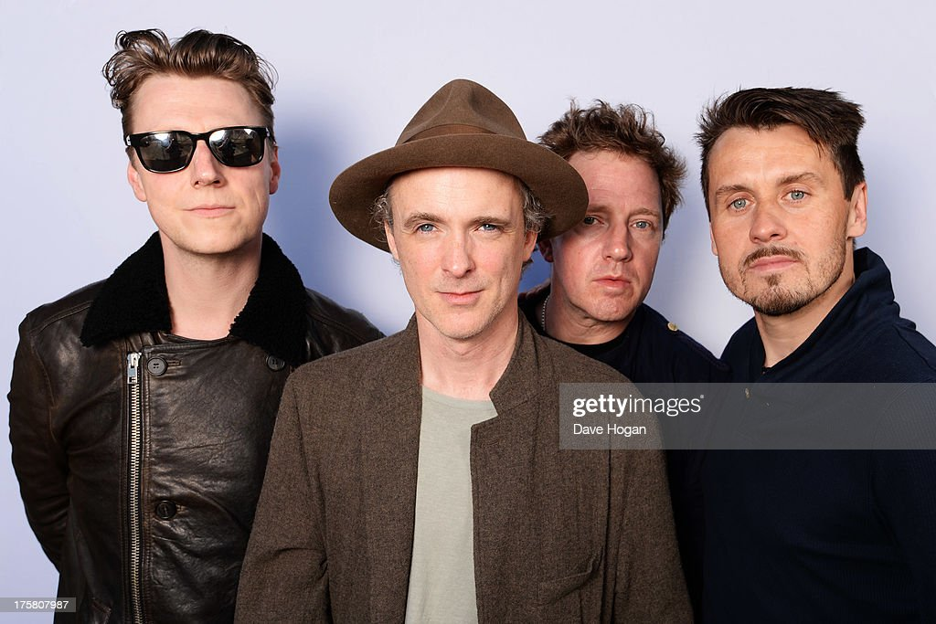 Fran Healy Andy Dunlop Dougie Payne and Neil Primrose of Travis pose at a Biz Session on June 14 2013 in London England