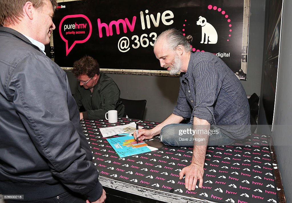 Fran Healy of Travis meets a fan after performing songs from the new album 'Everything At Once' at HMV Oxford Street on April 30, 2016 in London, England.