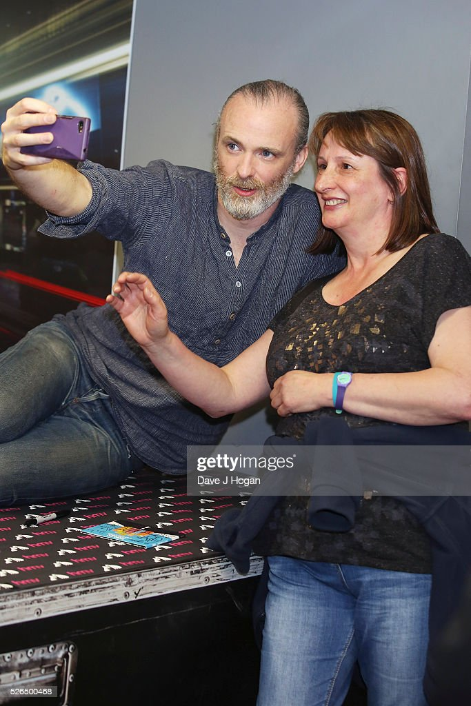 Fran Healy of Travis takes photos with fans after performing songs from the new album 'Everything At Once' at HMV Oxford Street on April 30, 2016 in London, England.