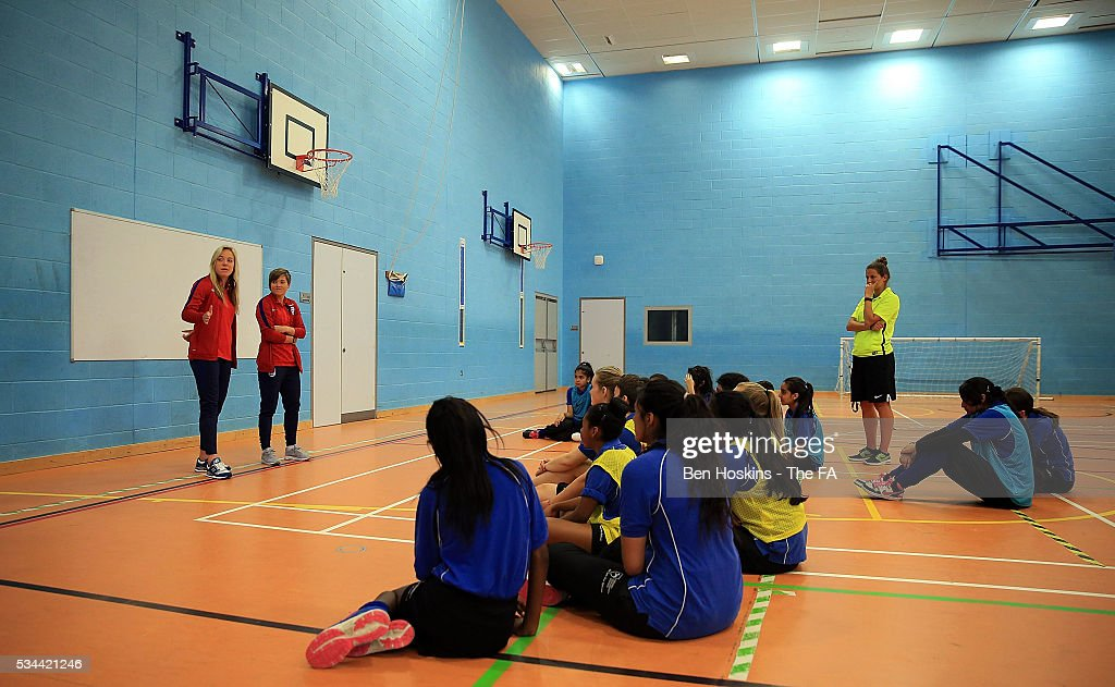 Fran Kirby and Gemma Davison of England attend the Cressex Community School during the England Women v Serbia Women: Media Day on May 26, 2016 in High Wycombe, England.