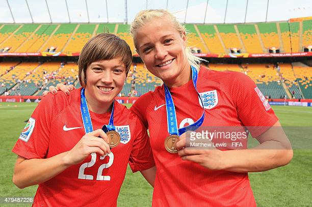 Fran Kirby and Katie Chapman of England celebrate their teams third place after defeating Germany during the FIFA Women's World Cup 2015 Third Place...