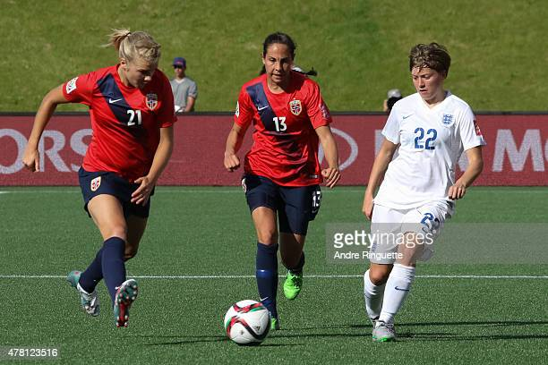 Fran Kirby of England controls the ball against Ada Hegerberg and Ingrid Moe Wold of Norway during the FIFA Women's World Cup Canada 2015 round of 16...