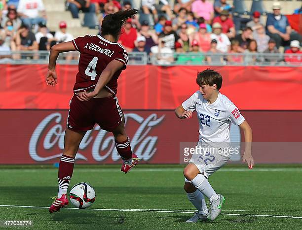 Fran Kirby of England gets around Alina Garciamendez of Mexico to score in the second half during the FIFA Women's World Cup 2015 Group F match at...