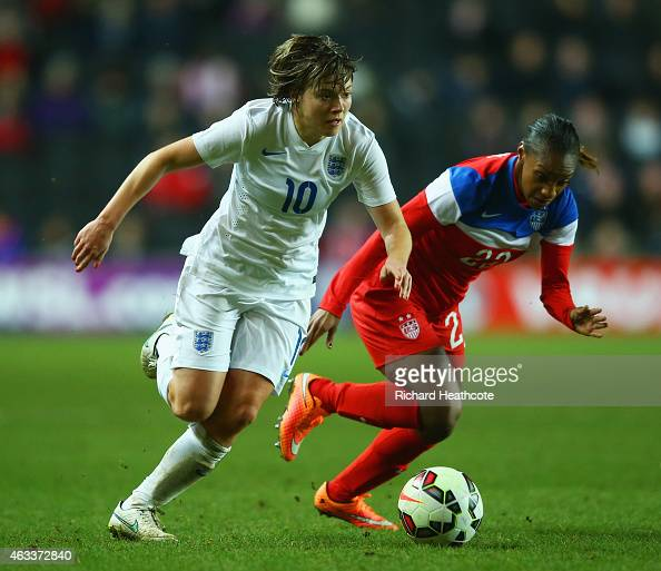 Fran Kirby of England is chased by Crystal Dunn of the United States during the Women's Friendly International match between England and USA at...