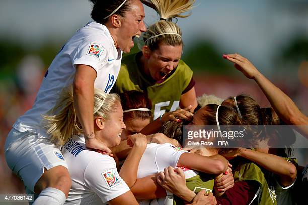 Fran Kirby of England is congratulated by her team after scoring during the FIFA Women's World Cup 2015 Group F match between England and Mexico at...