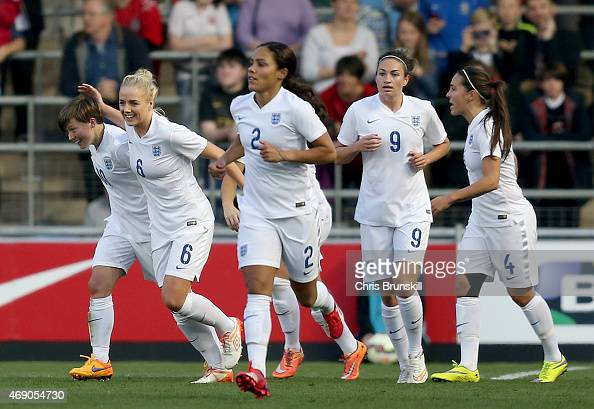 Fran Kirby of England is congratulated by her teammates after scoring her side's second goal during the Women's Friendly International match between...