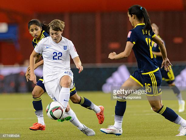 Fran Kirby of England tries to move the ball past Lady Andrade of Colombia during the 2015 FIFA Women's World Cup Group F match at Olympic Stadium on...