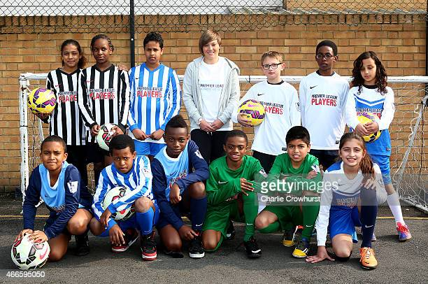 Fran Kirby poses for a photograph with the school children during the Premier League Players Kit Scheme Launch at Allen Edward Primary School on...
