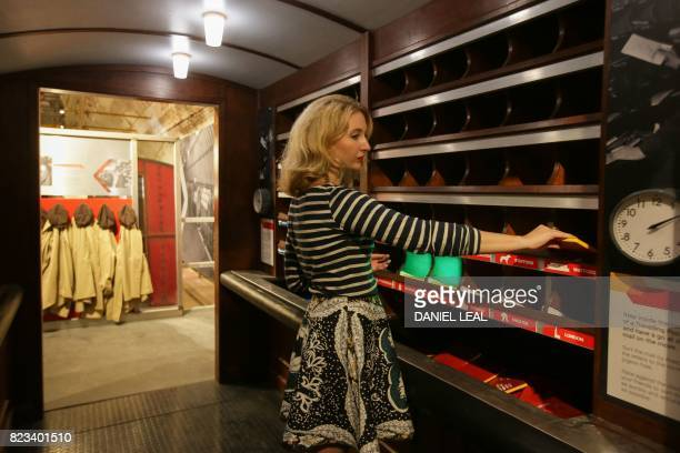 01 GMT / Fran LangdonDevlin a staff member poses for a picture at a traveling post office during a media preview of the new Postal Museum and the...