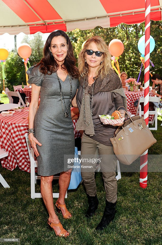 Fran Lasker and <a gi-track='captionPersonalityLinkClicked' href=/galleries/search?phrase=Rosanna+Arquette&family=editorial&specificpeople=206134 ng-click='$event.stopPropagation()'>Rosanna Arquette</a> attend HEART/Stella McCartney Brunch on March 13, 2013 in Beverly Hills, California.