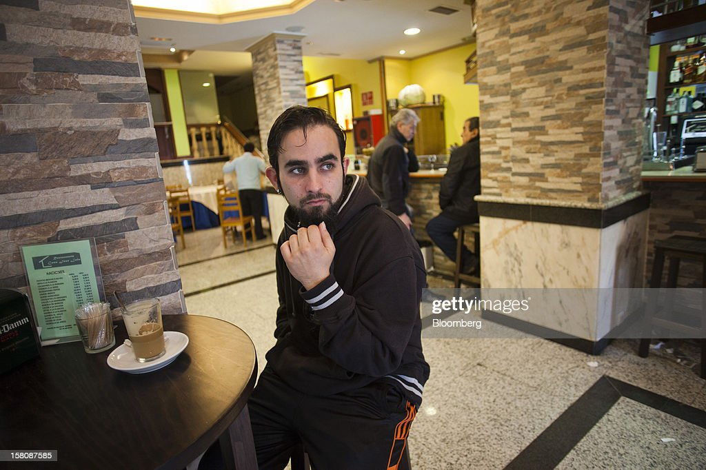 Fran Lopez, a jobless electrician, drinks a glass of coffee at a bar near his home in Madrid, Spain, on Monday, Dec. 10, 2012. The jobless rate in Lopez's native Spain stands at 26 percent, jostling with Greece for the rank of highest on the continent. Photographer: Photographer: Angel Navarrete/Bloomberg via Getty Images