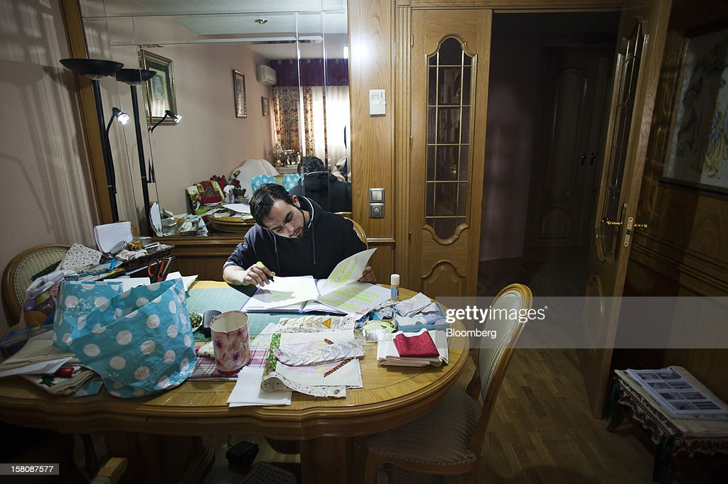 Fran Lopez, a jobless electrician, studies in the dining room of his parent's home in Madrid, Spain, on Monday, Dec. 10, 2012. The jobless rate in Lopez's native Spain stands at 26 percent, jostling with Greece for the rank of highest on the continent. Photographer: Photographer: Angel Navarrete/Bloomberg via Getty Images