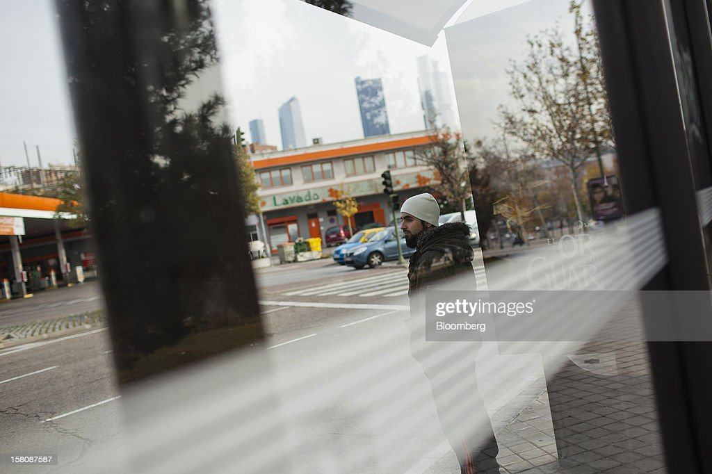 Fran Lopez, a jobless electrician, waits at a bus station near his home in Madrid, Spain, on Monday, Dec. 10, 2012. The jobless rate in Lopez's native Spain stands at 26 percent, jostling with Greece for the rank of highest on the continent. Photographer: Photographer: Angel Navarrete/Bloomberg via Getty Images