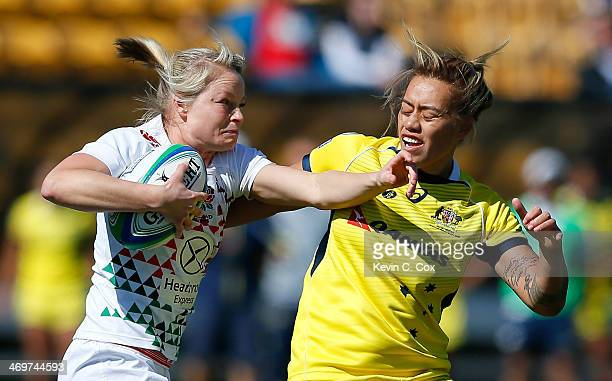 Fran Matthews of England breaks a tackle by Hanna Sio of Australia during the Women's Sevens World Series at Fifth Third Bank Stadium on February 16...