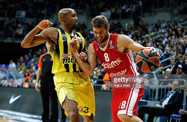 Fran Pilepic #8 of Cedevita Zagreb competes with Ricky Hickman #3 of Fenerbahce Istanbul during the Turkish Airlines Euroleague Basketball Top 16...
