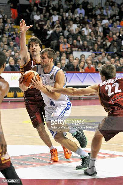 Fran Pilepic of Red October competes with Ariel Filloy and Jeff Viggiano of Umana during the LegaBasket of Serie A1 match between Reyer Umana Venezia...