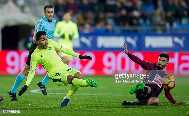 Fran Rico of SD Eibar duels for the ball with Petros Matheus dos Santos of Real Betis during the La Liga match between SD Eibar and Real Betis...