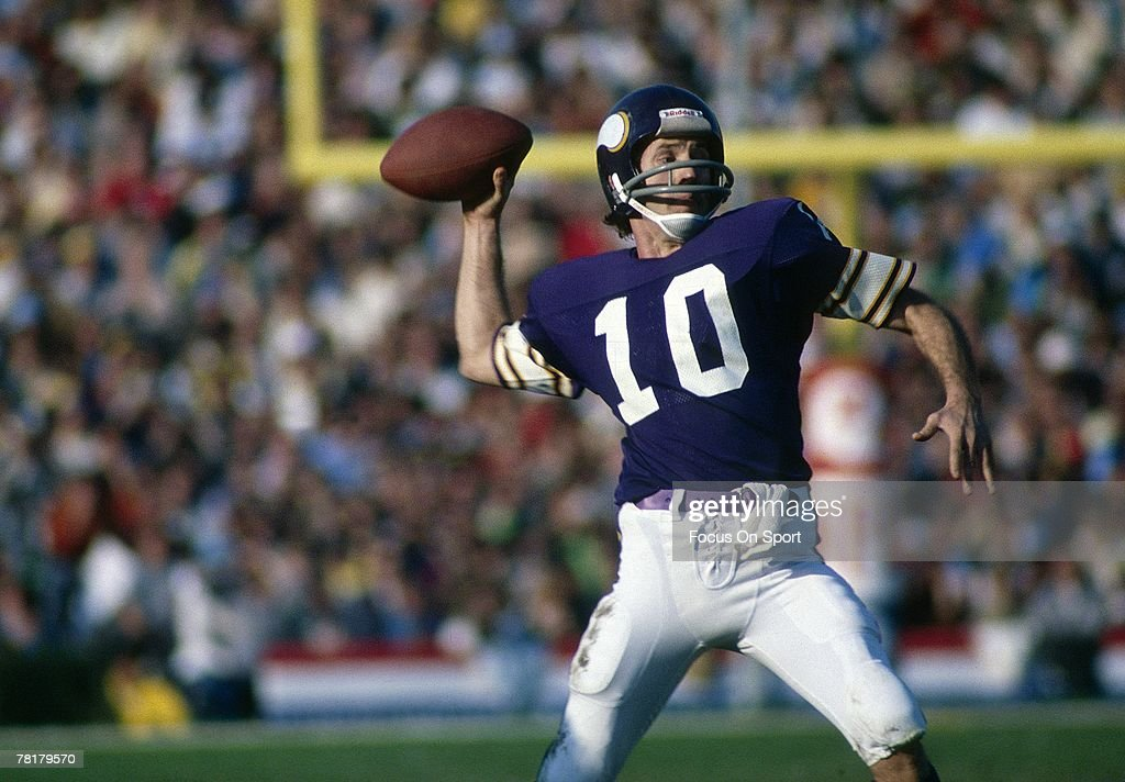 Fran Tarkington of the Minnesota Vikings drops back to pass against the Oakland Raiders during Super Bowl XI on January 9 1977 at the Rose Bowl in...