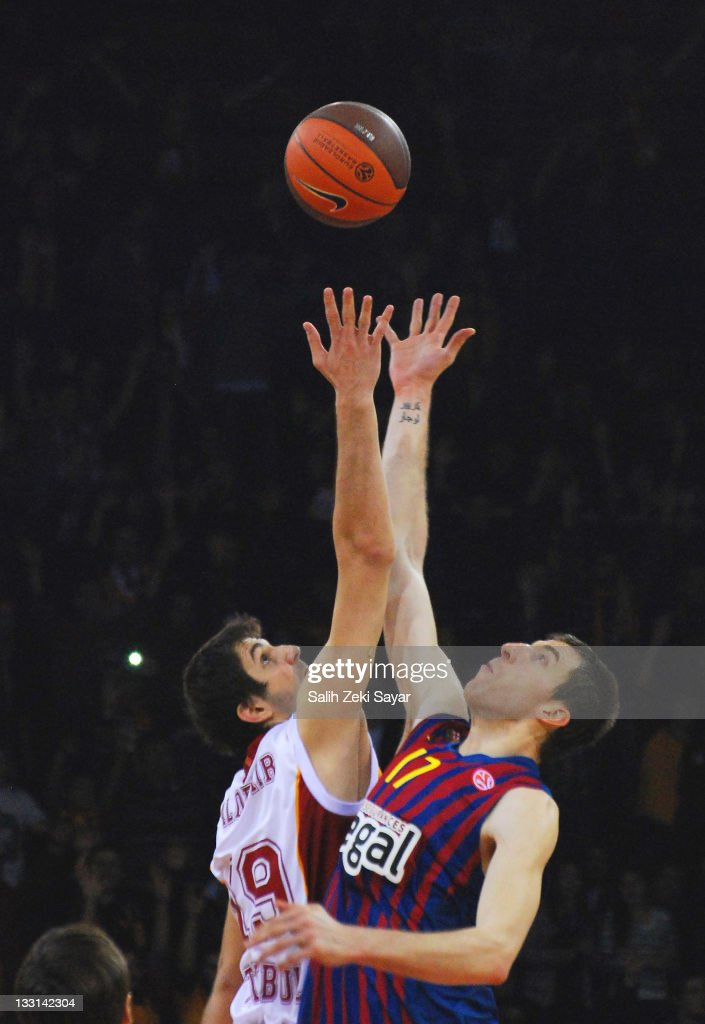 Fran Vazquez, #17 of FC Barcelona regal and Furkan Aldemir, #19 of Galatasaray Medical Park reaching for the first ball at the beginning of the 2011-2012 Turkish Airlines Euroleague Regular Season Game Day 5 between Galatasaray Medical Park v FC Barcelona Regal at Abdi Ipekci Sports Arena on November 17, 2011 in Istanbul, Turkey.