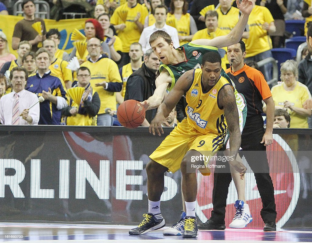 Fran Vazquez, #17 of Unicaja Malaga competes with <a gi-track='captionPersonalityLinkClicked' href=/galleries/search?phrase=Deon+Thompson&family=editorial&specificpeople=4026290 ng-click='$event.stopPropagation()'>Deon Thompson</a>, #9 of Alba Berlin during the 2012-2013 Turkish Airlines Euroleague Top 16 Date 7 between Alba Berlin v Unicaja Malaga at O2 World on February 14, 2013 in Berlin, Germany.