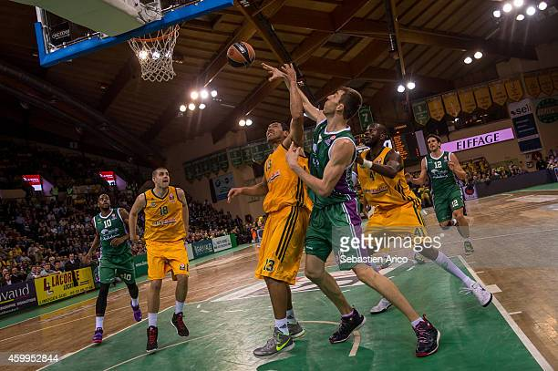 Fran Vazquez #17 of Unicaja Malaga competes with Joao Paulo Batista #13 of Limoges CSP during the 20142015 Turkish Airlines Euroleague Basketball...
