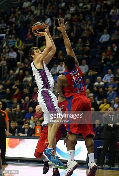 Fran Vazquez #17 of Unicaja Malaga competes with Kyle Hines #42 of CSKA Moscow in action during the Euroleague Basketball Top 16 Date 4 game between...