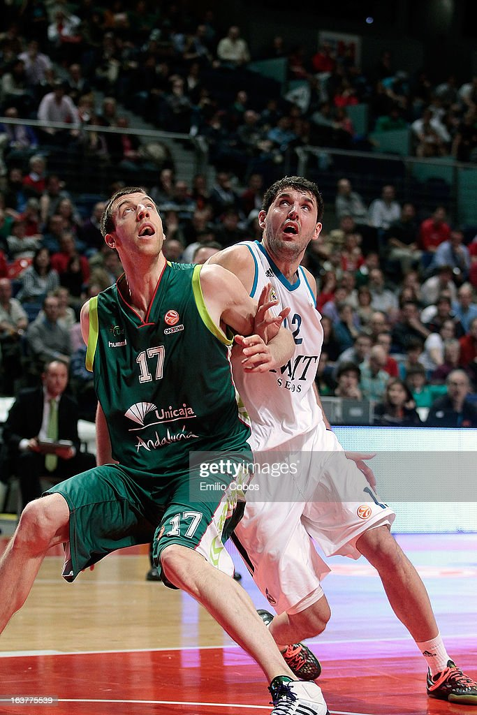 Fran Vazquez, #17 of Unicaja Malaga competes with Nikola Mirotic, #12 of Real Madrid during the 2012-2013 Turkish Airlines Euroleague Top 16 Date 11 between Real Madrid v Unicaja Malaga at Palacio Deportes Comunidad de Madrid on March 15, 2013 in Madrid, Spain.