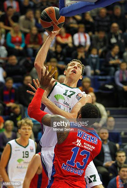 Fran Vazquez #17 of Unicaja Malaga competes with Sonny Weems #13 of CSKA Moscow in action during the 20142015 Turkish Airlines Euroleague Basketball...