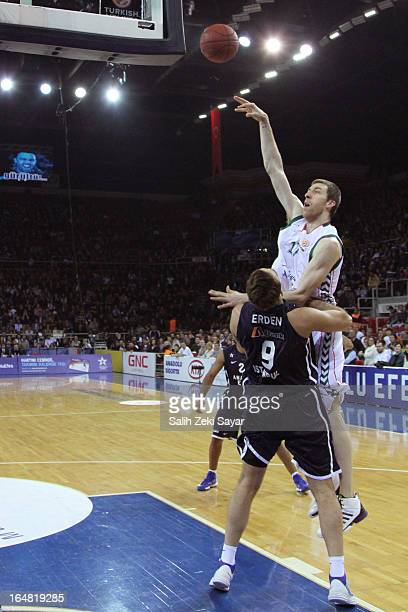 Fran Vazquez of Unicaja Malaga competes with Semih Erden of Anadolu Efes during the 20122013 Turkish Airlines Euroleague Top 16 Date 13 between...