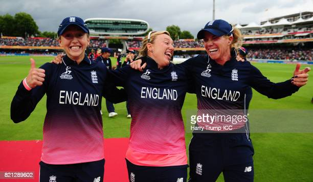 Fran Wilson Danielle Hazell and Lauren Winfield of England celebrate during the ICC Women's World Cup 2017 Final between England and India at Lord's...