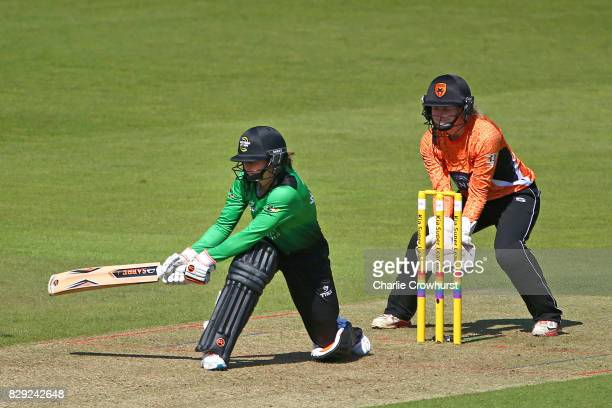 Fran Wilson of Western Storm hits out while Carla Rudd of Southern Vipers looks on during the Kia Super League Match between Southern Vipers and...