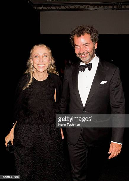 Franca Sozzani and Remo Ruffini attend the amfAR Milano 2014 Gala Dinner and Auction as part of Milan Fashion Week Womenswear Spring/Summer 2015 on...