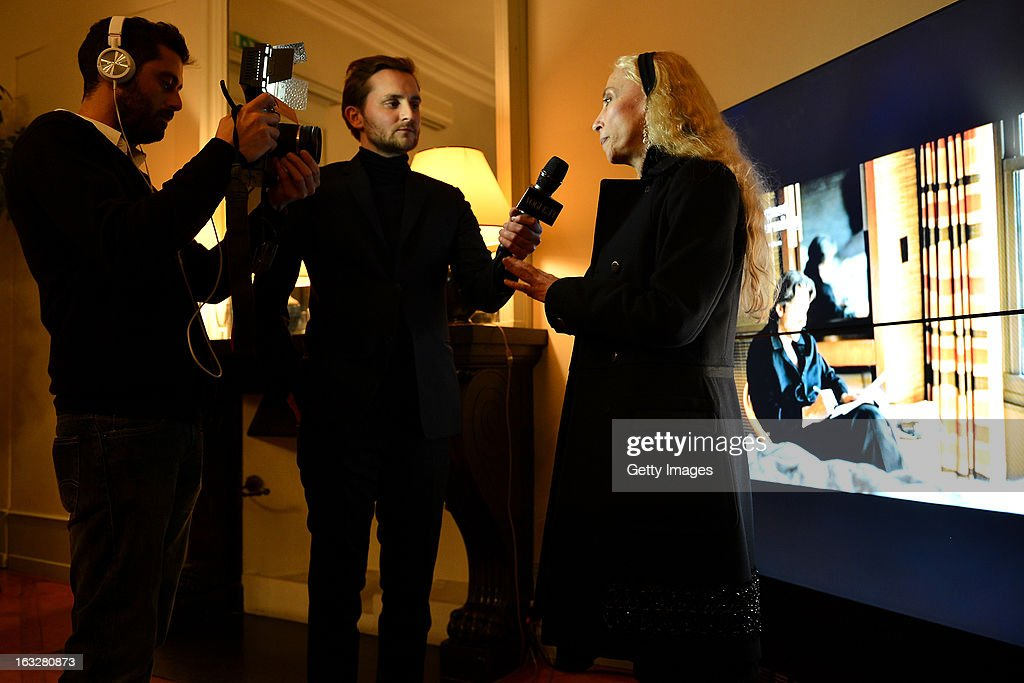 Franca Sozzani(R), Vogue Italia Editor in Chief, gives an interview during the charity auctioning of the first 'Citroen DS3 Cabrio L'Uomo Vogue' hosted by L'Uomo Vogue and Citroen at the Permanent Mission of France to the United Nations Office on March 6, 2013 in Geneva, Switzerland.