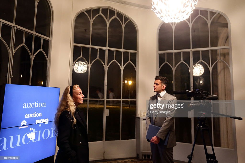Franca Sozzani(L), Vogue Italia Editor in Chief, gives an interview during the charity auctioning of the first 'Citroen DS3 Cabrio L'Uomo Vogue' hosted by L'Uomo Vogue and Citroen at the Permanent Mission of France to the United Nations Office on March 6, 2013 in Geneva, Switzerland.
