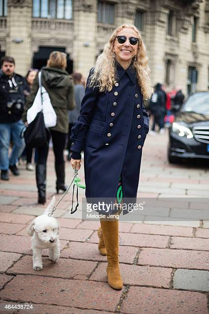 Franca Sozzani Vogue Italia EditorInChief exits the Gucci show at Piazza Oberdan with her dog on February 25 2015 in Milan Italy