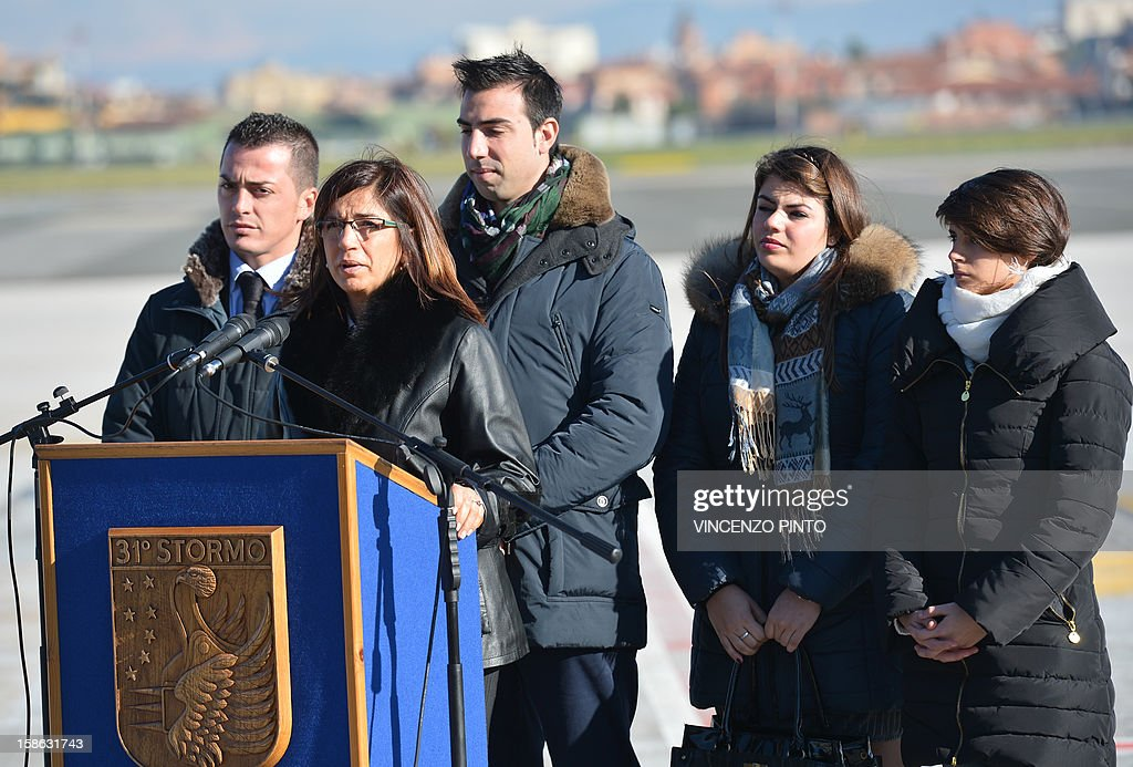 Franca, the sister of Italian marine Massimiliano Latorre, addresses journalists prior the arrival of her brother at Ciampino's airport, near Rome, on December 22, 2012. An Indian court allowed two Italian marines awaiting trial for shooting two fishermen to go home for Christmas, despite prosecution fears that they will not return. The marines shot dead the fishermen off India's southwestern coast near the port city of Kochi in February while guarding an Italian oil tanker, but they deny murder on the grounds that they mistook their victims for pirates.