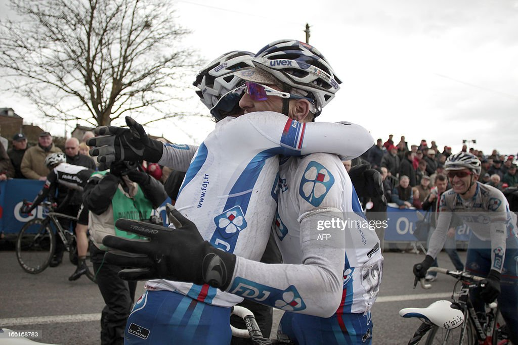 Francaise Des Jeux's team French Pierrick Fedrigo (L), is congratulated by his teammate Anthony Geslin, after winning the 74th edition of the Paris-Camembert cycling race on April 9, 2013 in Vimoutiers, northwestern France. Fedrigo won the race ahead of AG2R La Mondiale's team Sylvain Georges and Europcar's team Pierre Rolland.