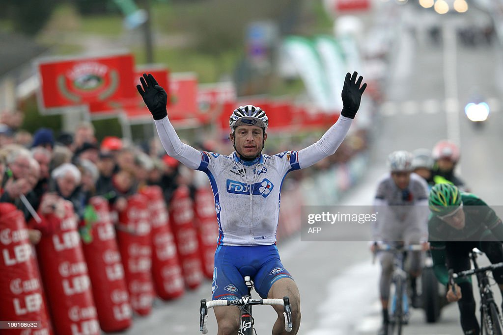 Francaise Des Jeux's team Pierrick Fedrigo, celebrates as he crosses the finish line of the 74th edition of the Paris-Camembert cycling race on April 9, 2013 in Vimoutiers, northwestern France. Fedrigo won the race ahead of AG2R La Mondiale's team Sylvain Georges and Europcar's team Pierre Rolland.