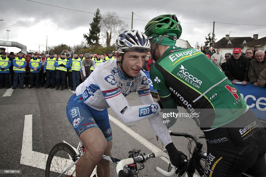 Francaise Des Jeux's team Pierrick Fedrigo (L) is congratulated by third-placed Europcar's team Pierre Rolland, at the end of the 74th edition of the Paris-Camembert cycling race on April 9, 2013 in Vimoutiers, northwestern France. Fedrigo won the race ahead of AG2R La Mondiale's team Sylvain Georges and Europcar's team Pierre Rolland.