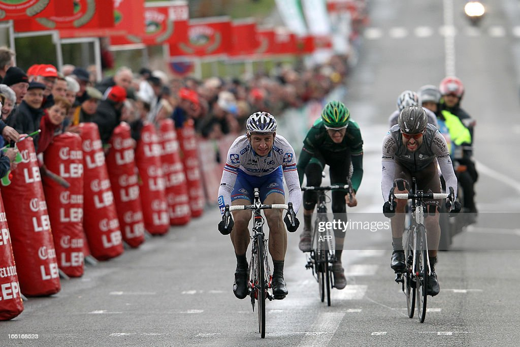 Francaise Des Jeux's team Pierrick Fedrigo (L), sprints on the finish line of the 74th edition of the Paris-Camembert cycling race on April 9, 2013 in Vimoutiers, northwestern France. Fedrigo won the race ahead of AG2R La Mondiale's team Sylvain Georges (R) and Europcar's team Pierre Rolland (C).