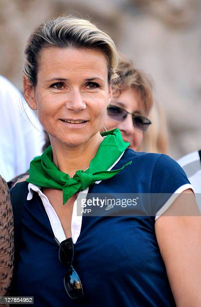 France 2 TV weather forecast presenter Nathalie Rihouet poses on October 2 before taking part in a 'Green ride' a bicycle tour in Paris to draw...