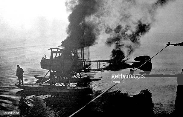 France 841916 World War I Capture of a German hydroplane in the North Sea by a French torpedo boat The pilot is getting ready to jump from the plane...