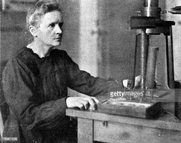 France A picture of Marie Curie the French physicist and chemist who pioneered research into cancer at work in her laboratory