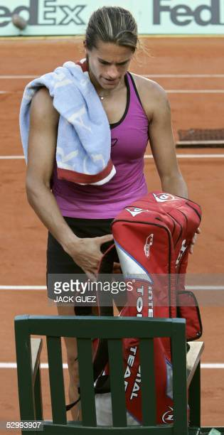 Amelie Mauresmo of France takes her bag before leaving the central court after loosing against Ana Ivanovic of Serbia for the third round match of...