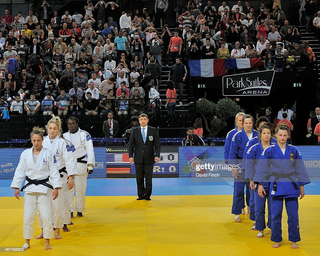 France (white) and Germany prepare for the Women's final that was won by the French team during the Montpellier European Team Judo Championships at the Park&Suites Arena on Sunday, April 2014 in Perols, Montpellier, France.