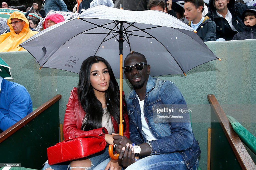 France and Liverpool professional footballer <a gi-track='captionPersonalityLinkClicked' href=/galleries/search?phrase=Mamadou+Sakho&family=editorial&specificpeople=4154099 ng-click='$event.stopPropagation()'>Mamadou Sakho</a> (R) and his companion Matja attend the 2015 Roland Garros French Tennis Open - Day Eight, on May 31, 2015 in Paris, France.