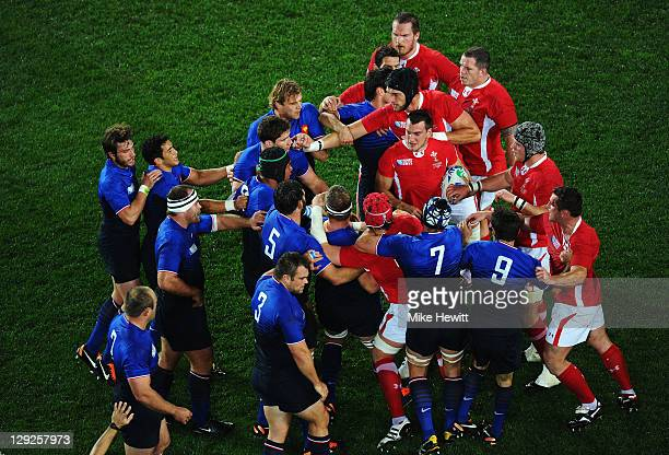 France and Wales players clash after a dangerous tackle on Vincent Clerc of France by Sam Warburton of Wales during semi final one of the 2011 IRB...