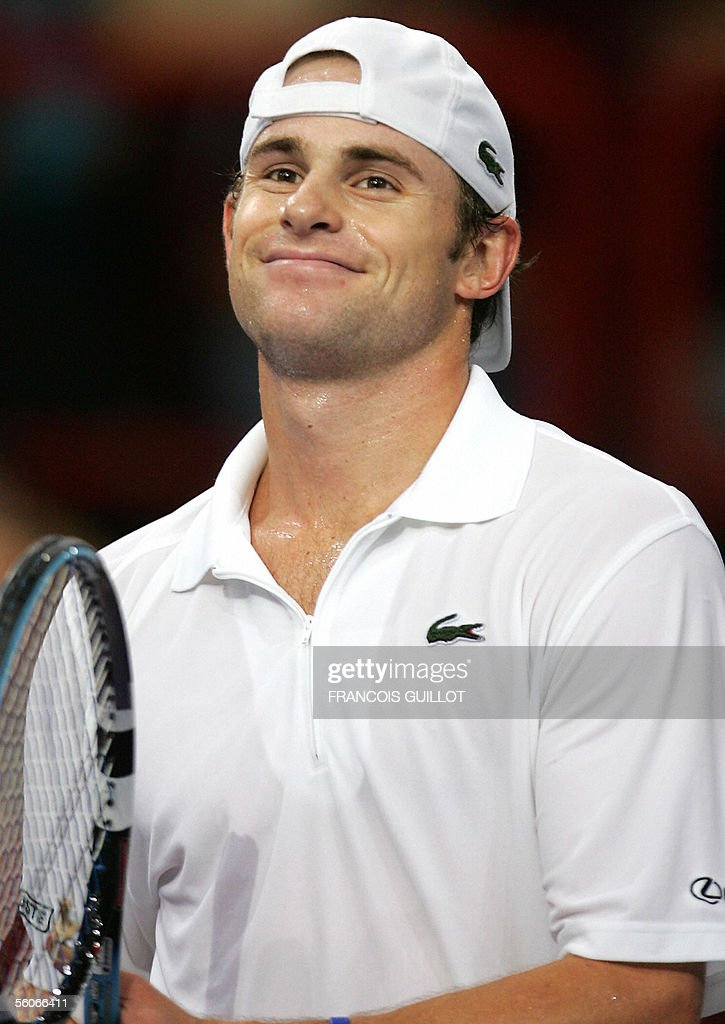 Andy Roddick of the US jubilates after winning over Dominik Hrbaty of Slovakia during their Paris Tennis Masters Series third round match at Bercy...
