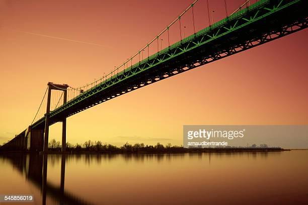 France, Aquitaine, Gironde, Bordeaux, Bridge of Aquitaine against orange evening sky